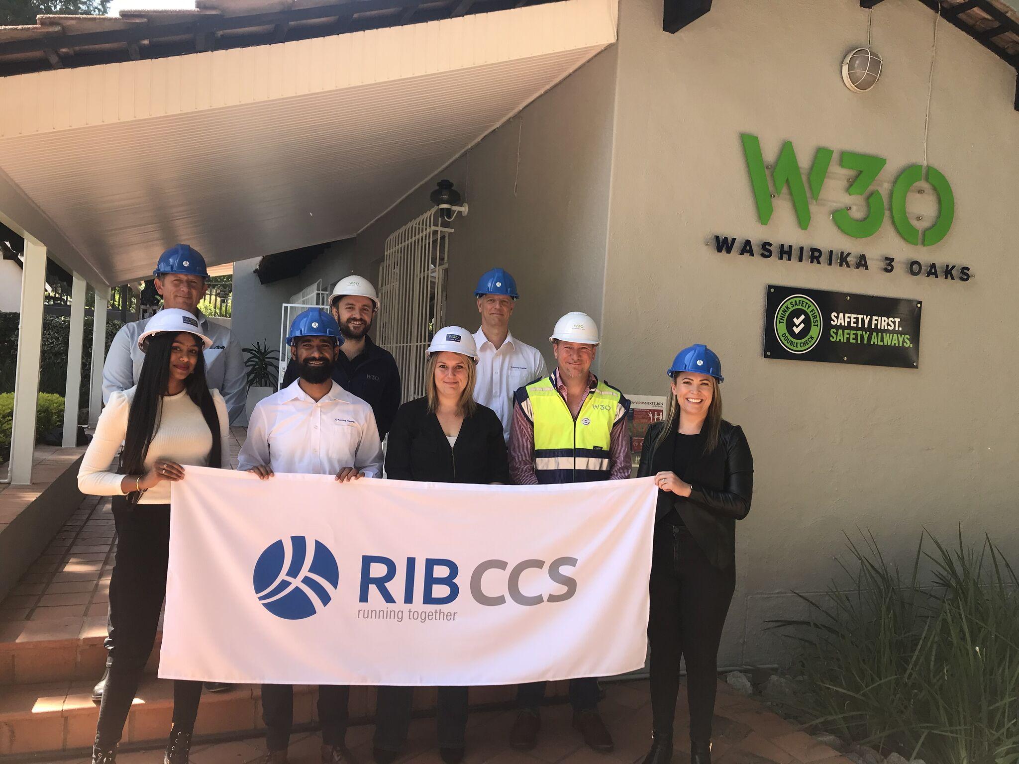Washirika 3 Oaks team members holding the RIB CCS banner