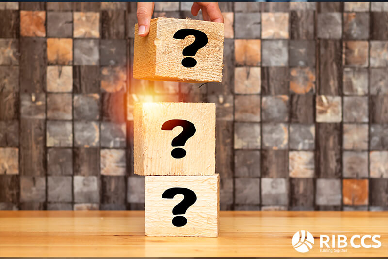 Three building blocks on top of each other with a question mark in each